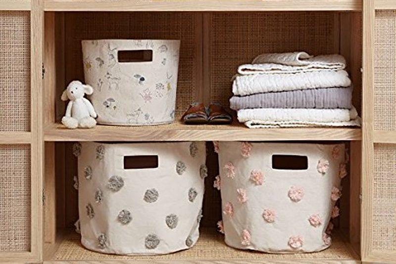 bins in an organized kids closet