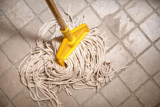mop on tile floor from above