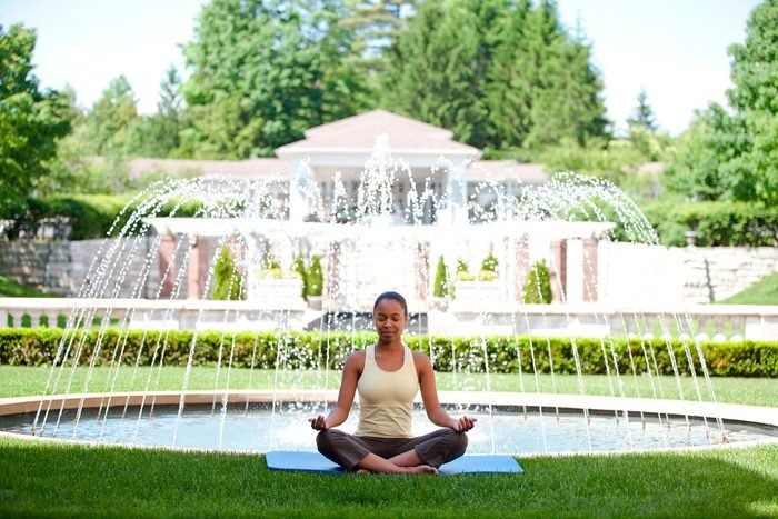 woman meditating in front of fountain at Canyon Ranch Lenox, massachusetts