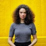 9 Genius Ways to Tame Frizzy Hair