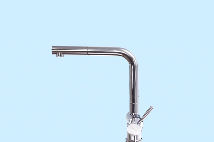 Close-Up Of Faucet Over Blue Background
