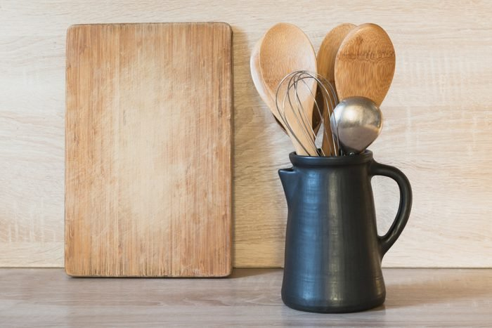 coking tools and cutting board in kitchen