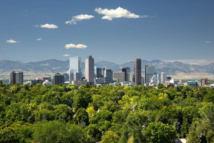 Denver, Colorado skyline with trees and mountains