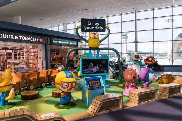 childrens play area inside an airport terminal
