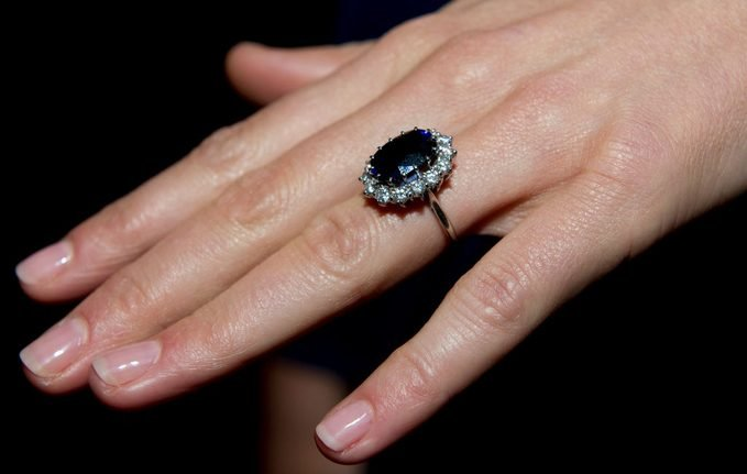 close up of princess diana's engagement ring on kate middleton's finger