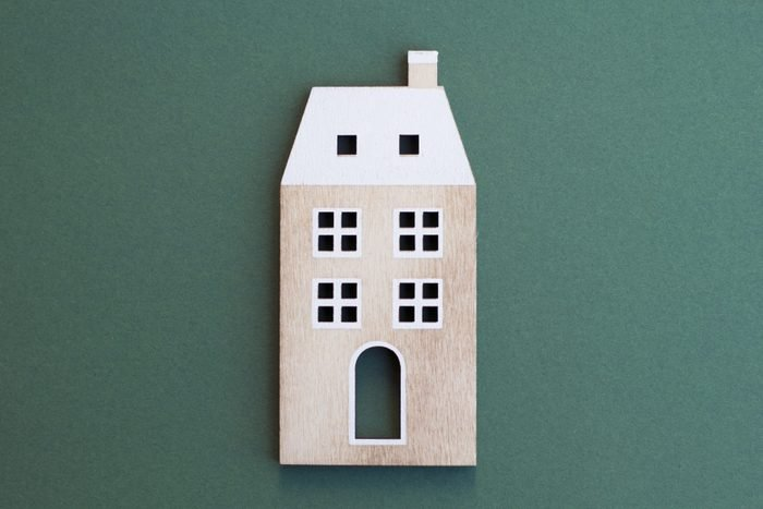 wooden apartment building on green background