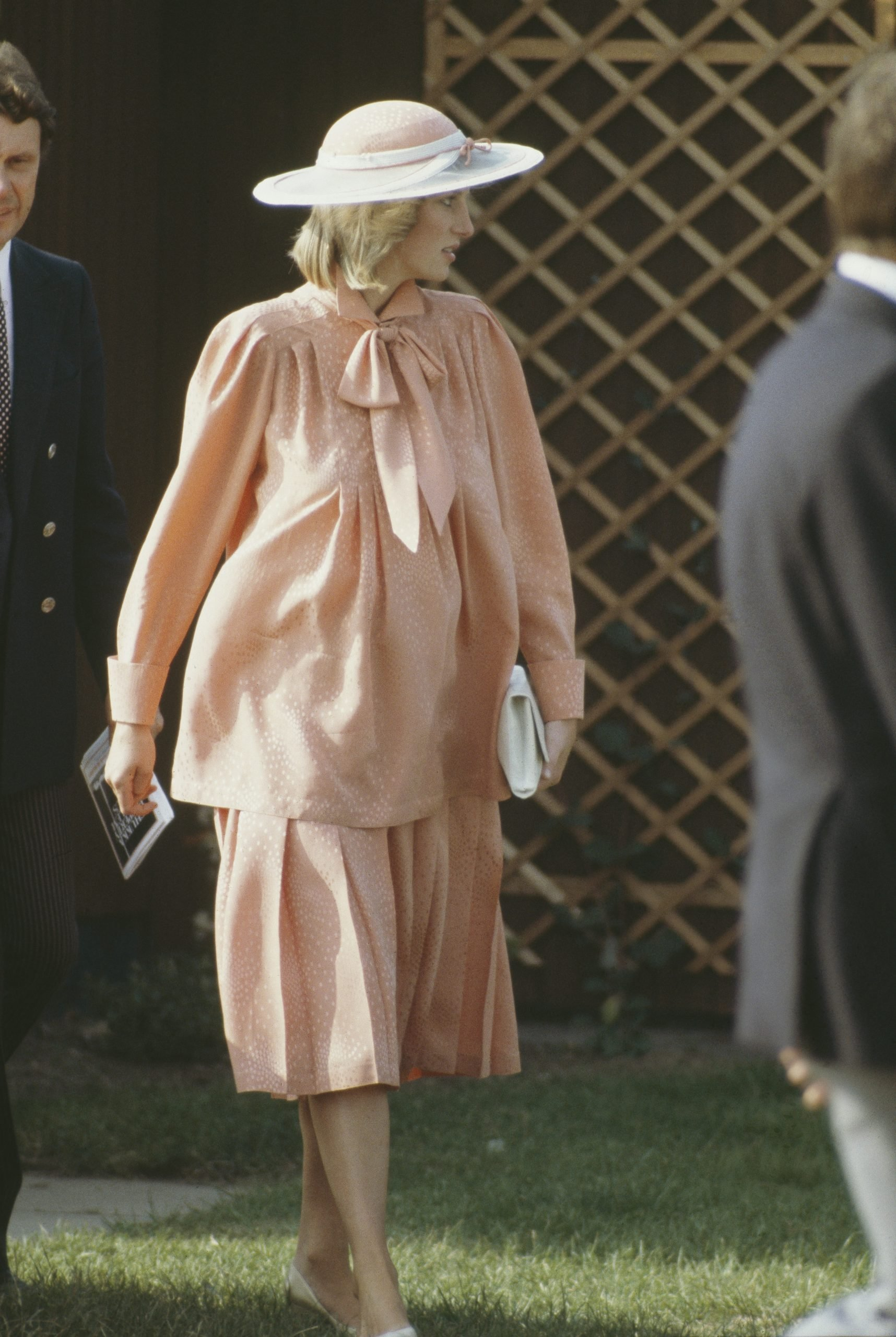 Diana, Princess of Wales at the Guards Polo Club in Windsor, June 1984. She is pregnant with Prince Harry, and wearing a Jan Van Velden maternity suit and hat by Frederick Fox.