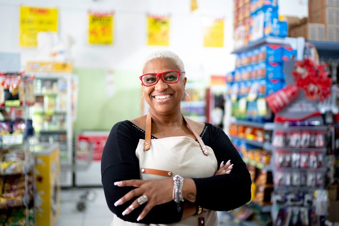 Portrait of happy mature employee at wholesale