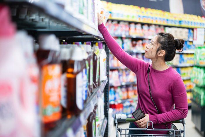 asian female buy washing powder in supermarket