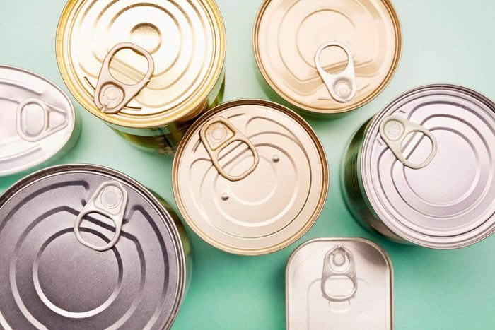Directly above shot of canned food on turquoise background