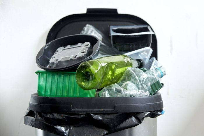 Used plastic containers filling up kitchen dustbin