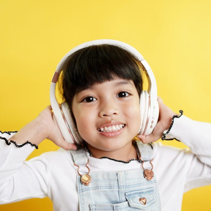 happy child listening to a podcast