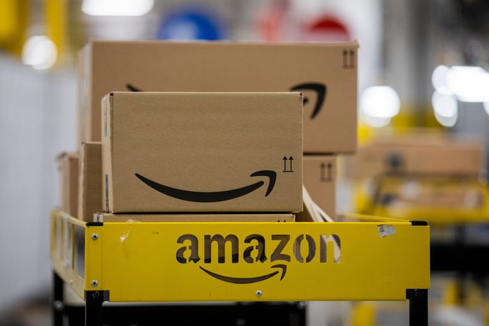amazon boxes on a cart in an amazon warehouse