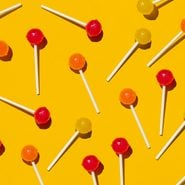 Pattern of lollipops against yellow background