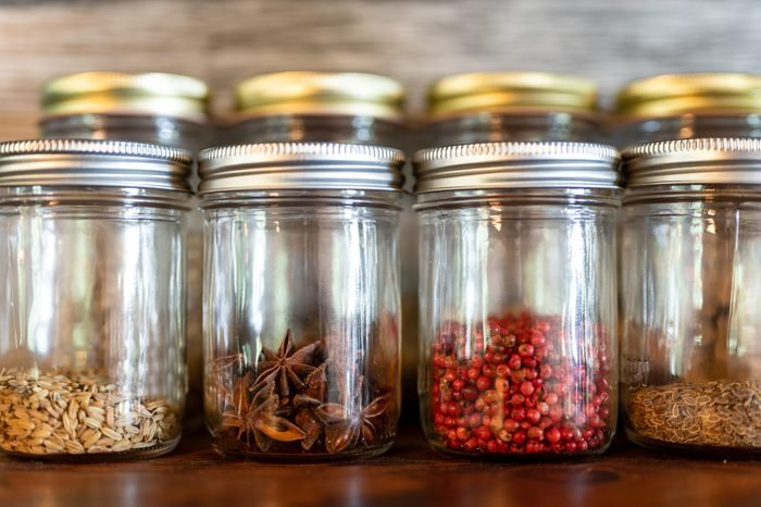 Assorted dried spices in glass jars