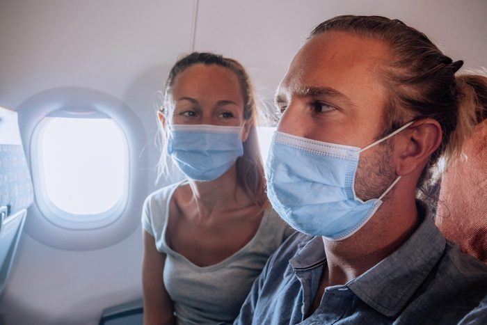 Couple traveling by plane - Coronavirus pandemic