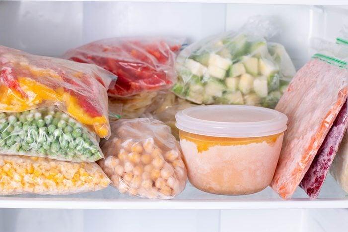 Frozen food in the freezer. Frozen vegetables, soup, ready meals