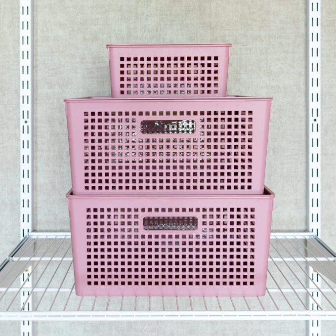 wire closet organizer shelf with stack of plasic bins