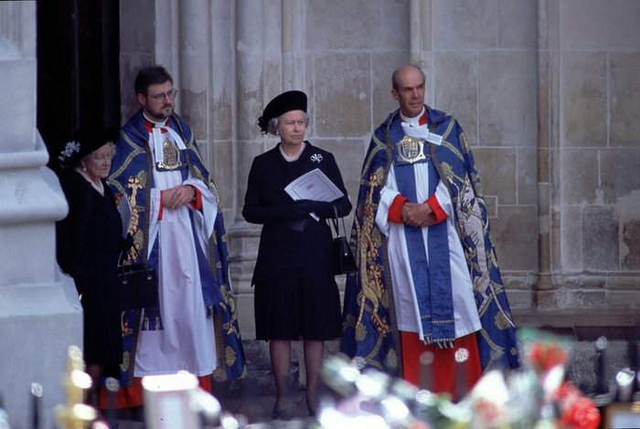 Queen Elizabeth II and Queen Mother at Funeral of Diana, Princess of Wales - At Westminster Abbey awaiting the arrival of the coffin of Diana, Princess of Wales, dressed in black standing next to priests