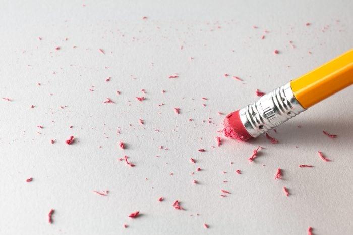 Pencil Erasing on White Paper