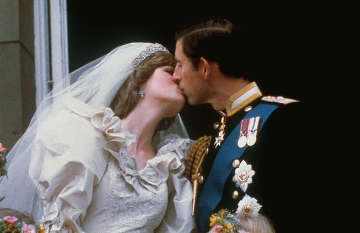 Wedding of Prince Charles and Lady Diana Spencer. Shows the famous kiss on the balcony of Buckingham Palace, after ceremony.