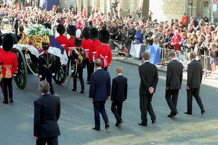 Onlookers line the street while the procession following Princess Diana's coffin walks through