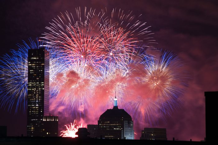Fireworks go off over the city of Boston for the 4th of July.