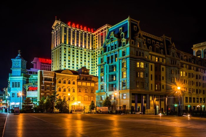 Buildings on the boardwalk at night in Atlantic City