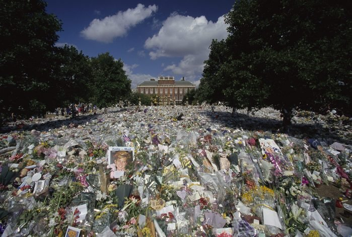 Mourners left dozens of bouquets, cards, and photographs outside Kensington Palace for the funeral of Diana, Princess of Wales