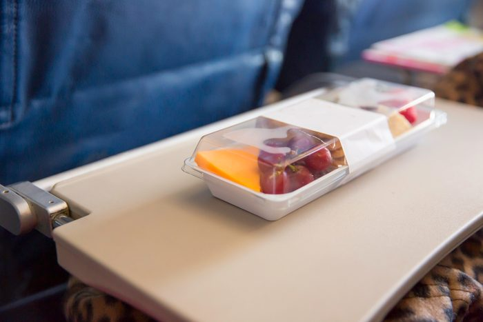 Purchased airplane food on tray in airplane