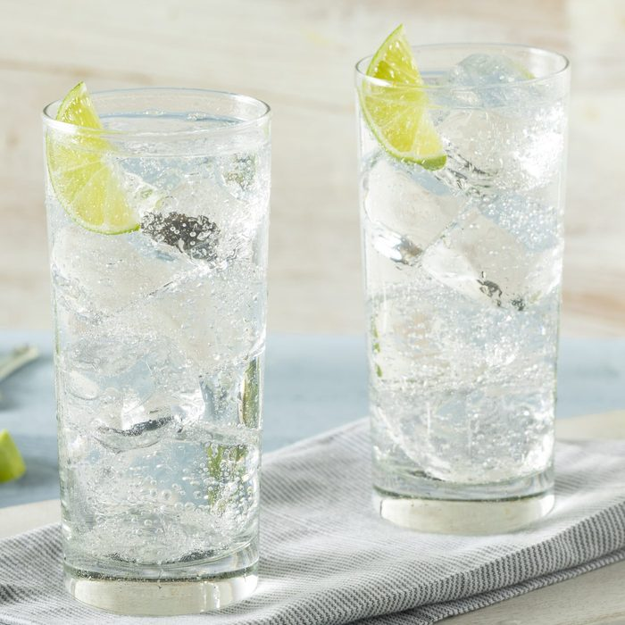 two glasses of clear diet soda with lime