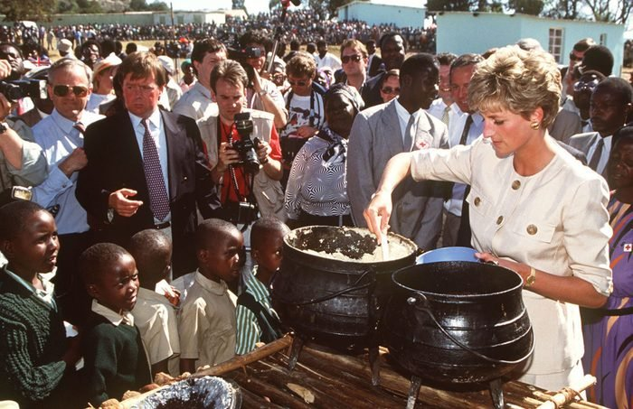 Princess Diana at the Nemazura feeding centre - a Red Cross project for refugees in Zimbabwe, July 1993. She is wearing a safari suit by Catherine Walker.