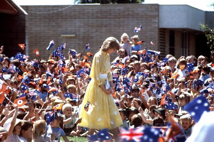 Princess Diana at the School of the Air, in Alice Springs, Australia, 30th March 1983. She is wearing a dress by Jan van Velden.