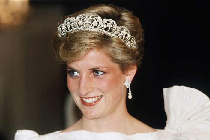 Diana, Princess of Wales, wearing a white dress designed by David and Elizabeth Emanuel with the Spencer Tiara, attends a State Banquet on November 16, 1986 in Bahrain.