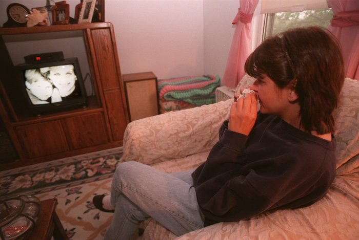 Christine Couture watches the televised funeral of Princess Diana of Wales in her living room in Arlington
