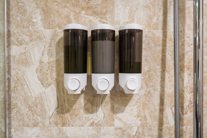 Box of Soap, shampoo, conditioner hang on wall in bathroom