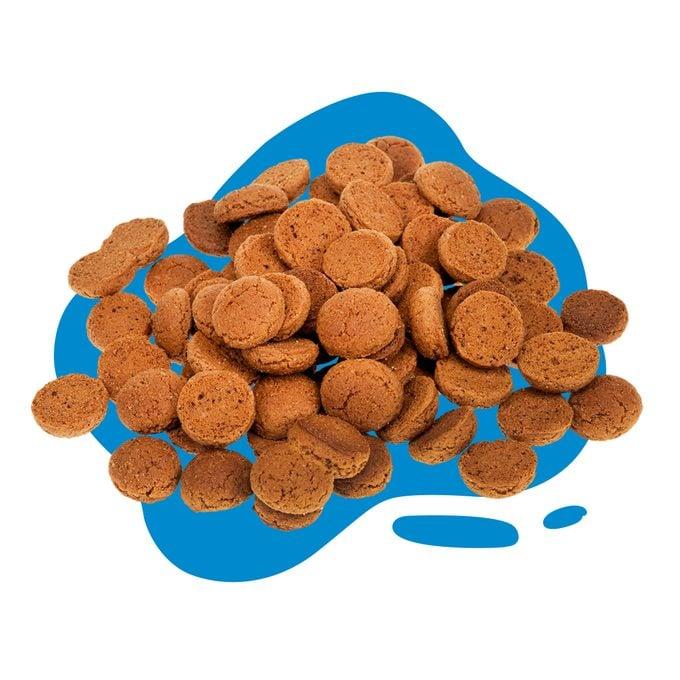 pile of pepernoten ( Pfeffernuesse) on blue blob background