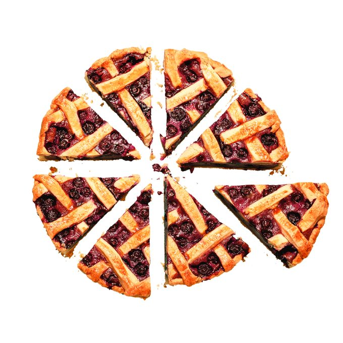 Above view of homemade pie with cherry filling. Fruitcake sliced in 8 portions