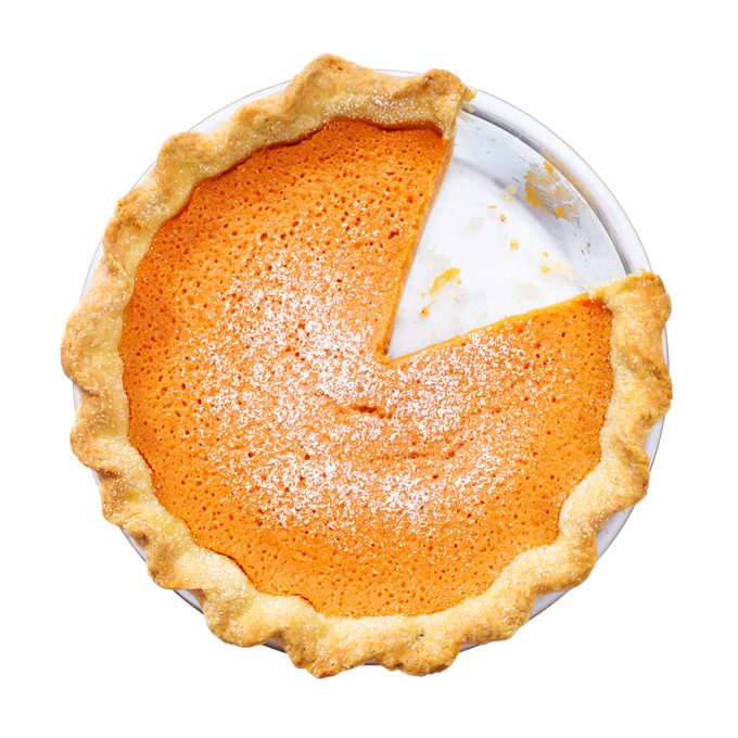 Overhead view of sweet potato pie with slice removed