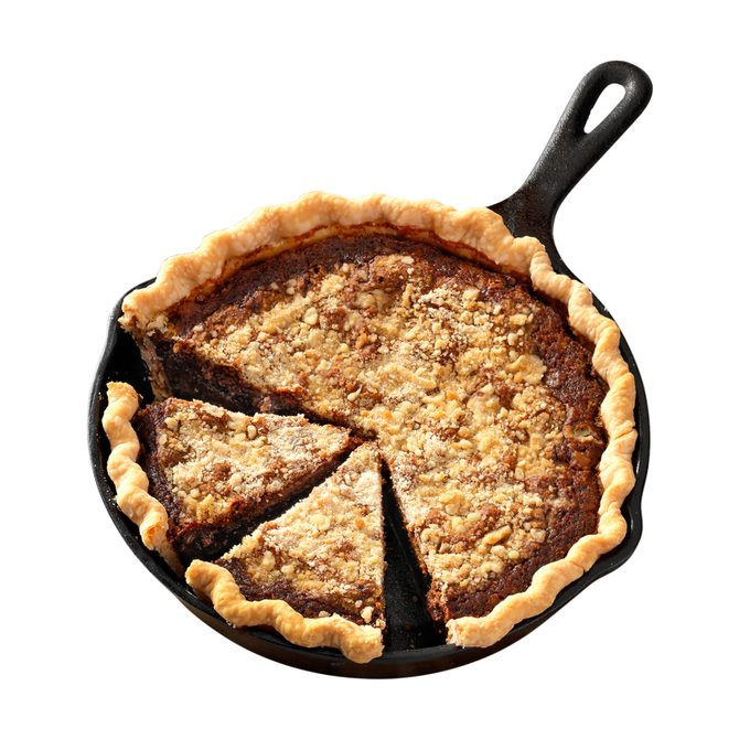 Shoofly pie in a pan with a few slices cut out