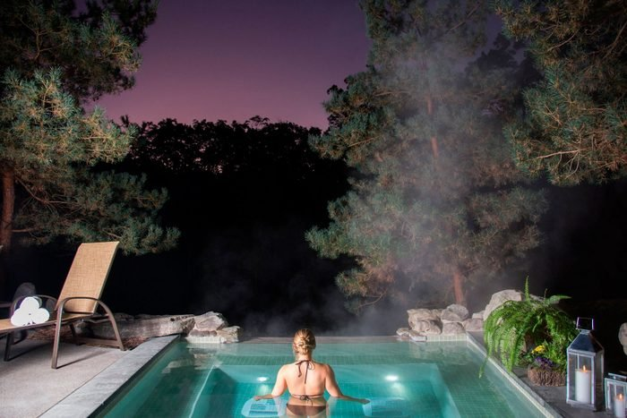 woman in a spa at night at The Lodge At Woodloch, pennslyvania