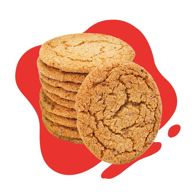 Stack of molasses cookies on red blob background