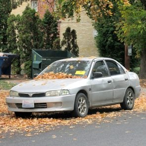 Abandoned Car with orange tag