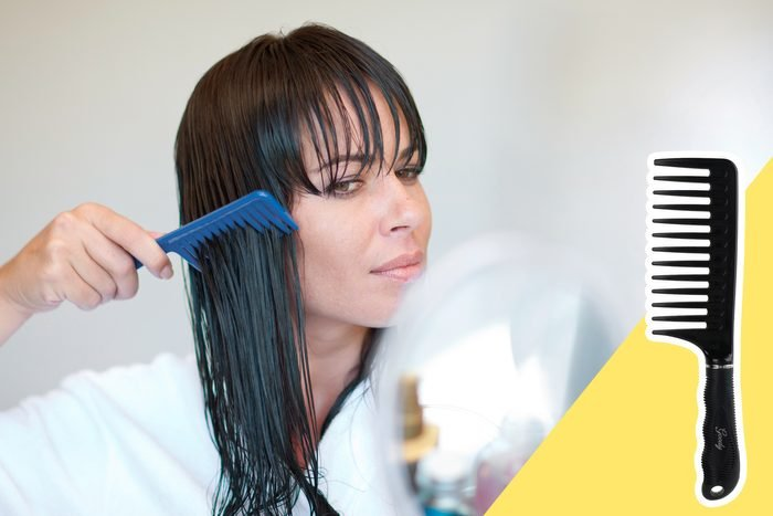woman combing leave in conditioner through her hair