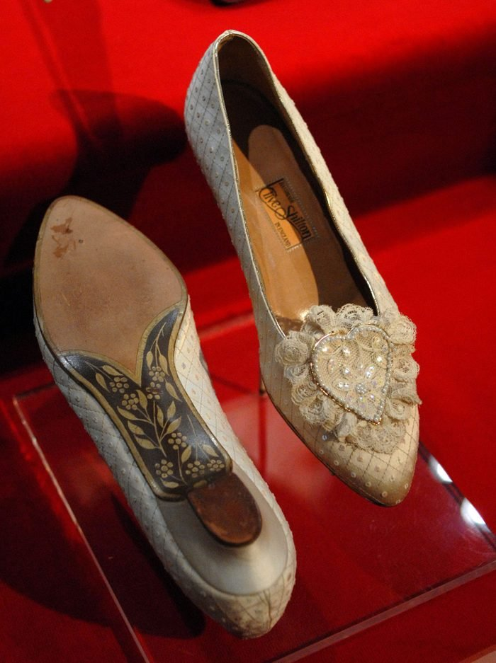 """Princess Diana's wedding slippers are displayed at a preview of the traveling """"Diana: A Celebration"""" exhibit at the National Constitution Center on October 1, 2009 in Philadelphia, Pennsylvania."""