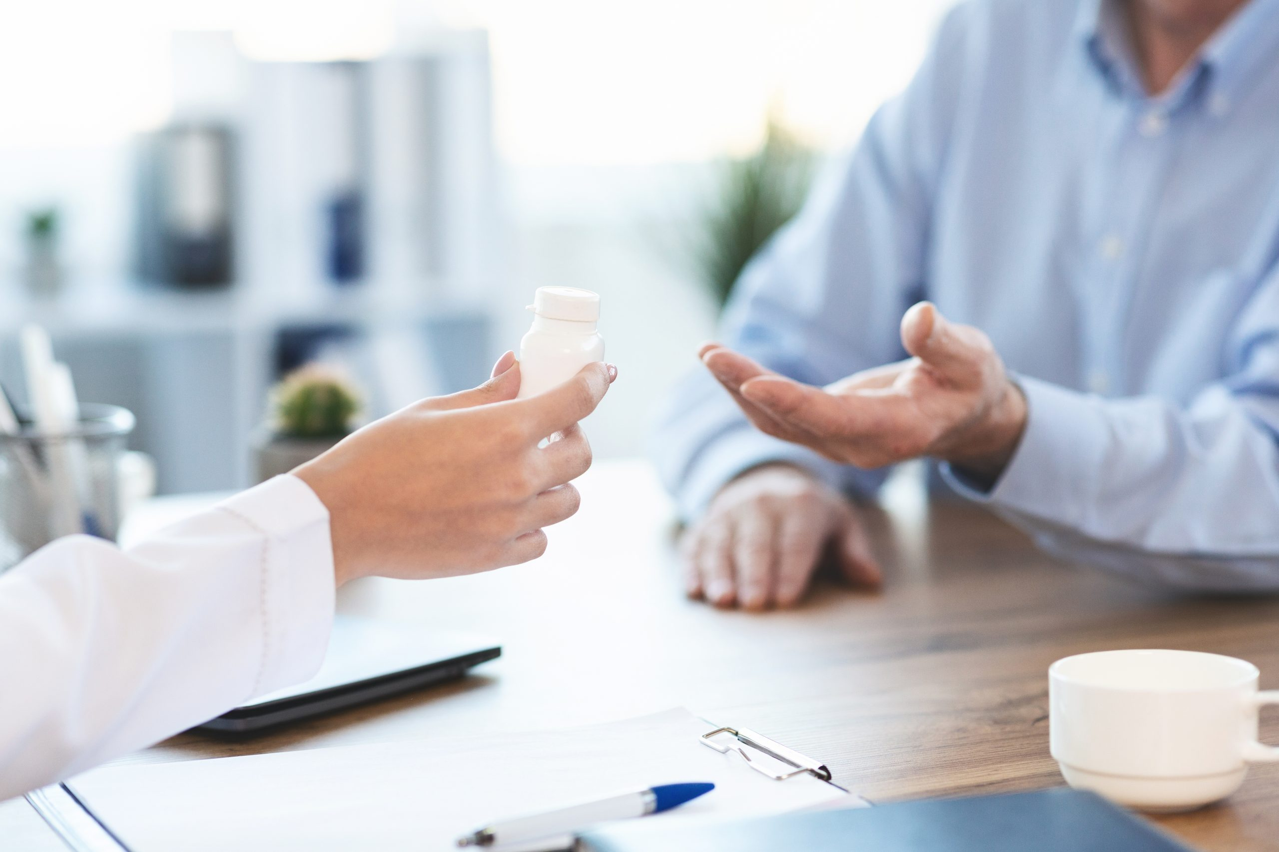 Medicine Concept. Close up of doctor giving medication pill bottle to retired man, copy space; Shutterstock ID 1591201198; Use (Print or Web): -; Client/Licensee: -