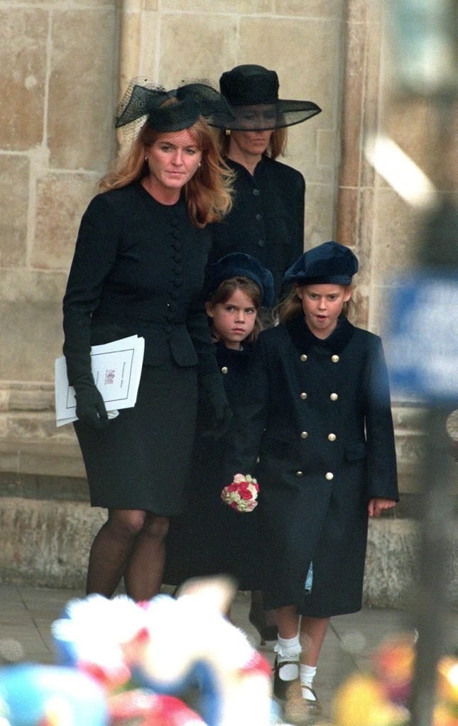 Sarah Ferguson, Duchess of York leaving Westminster Abbey with her two daughters Eugenie and Beatrice after the funeral service for Diana, Princess of Wales