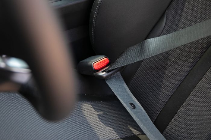Drivers side of the car seatbelt with no fabric loop