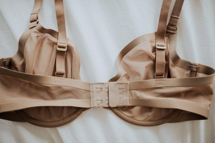 Beige Cuup bra on white bedding background