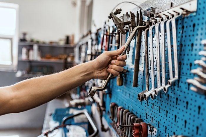 close up of hand grabbing tools
